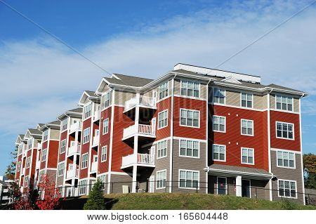 Close up on modern apartment building with blue sky