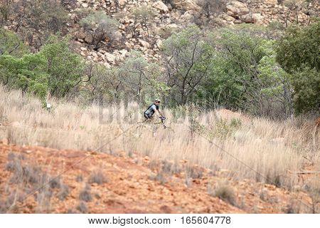 Cyclist Riding Down Mountain At Mountain Bike Race