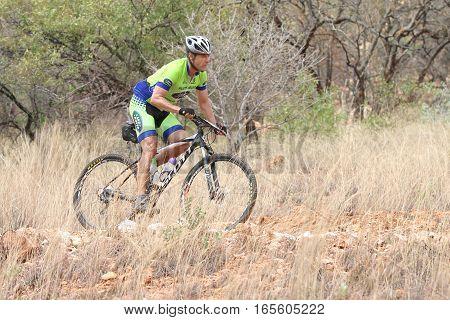 Middle Aged Male Riding Through Bush At Mathaithai Mountain Bike Race