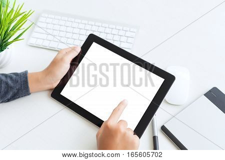 hand using digital tablet finger touch blank screen on desk work table