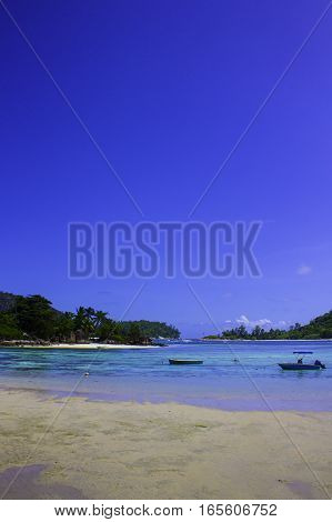 Seychelles Seascape with boats in Portrait format