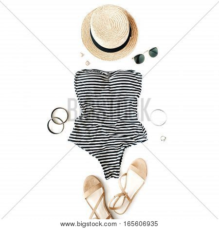 Feminine swimsuit beach accessories on white background. Flat lay top view