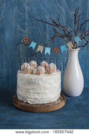 Birthday cake on wooden background. White milk and dark chocolate cake.