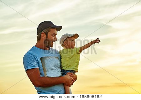 Happy loving family! The son sits on his father's shoulder