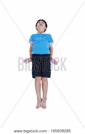 Happy cheerful barefoot asian child look like flying superhero, isolated on white background. Positive human emotion, facial expression feeling reaction. Studio shot.