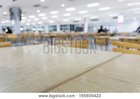 blurry empty canteen room. table and chair.