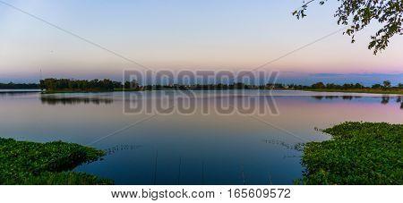 Beautiful sunrise on the lake and blue sky