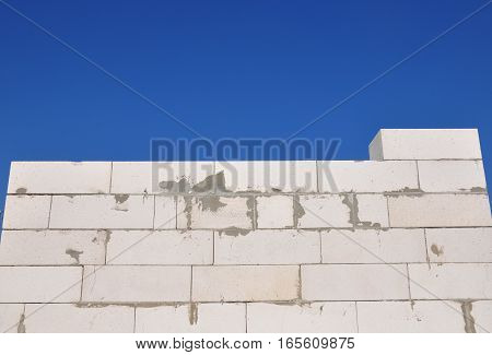 Building New House Bricklaying from Autoclaved Aerated Concrete Blocks Wall