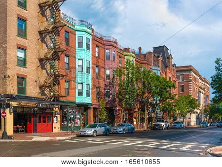 Boston - June 2016, USA: View of the typical street of Boston in Back Bay after the rain, old brick houses in traditional architecture style and cars parked near them