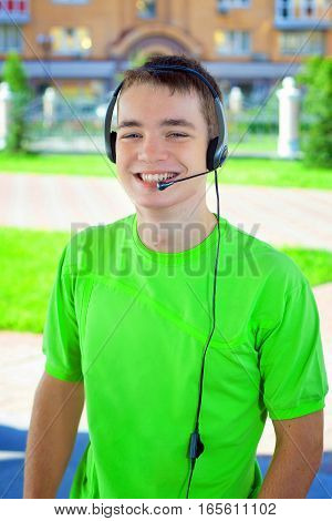 Portrait Of Young Man, Headset, Microphone; Emotional, Smiling