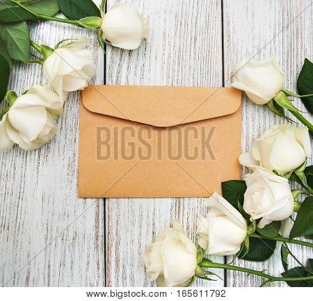 White Roses And Envelope