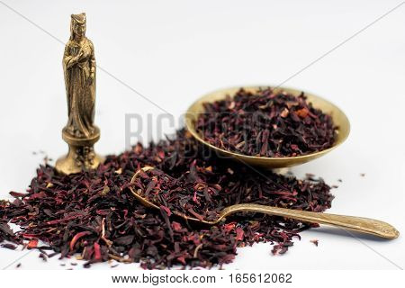 Dry Hibiscus Tea Leaves, Vintage Bronze Bowl And Spoon With Egyptian Statuette