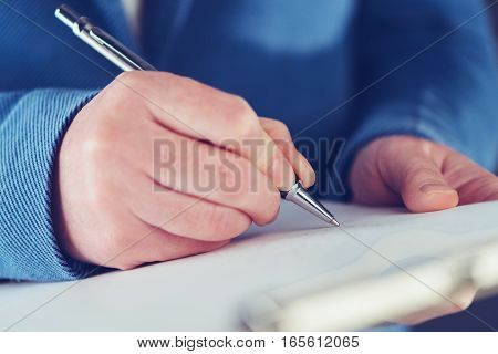 Businesswoman signing business contract agreement close up of female hand with pencil writing signature