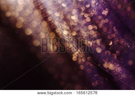 Glitter and glow soft multi colored bokeh shining . Dark abstract dreamy wonderful sparkle background.