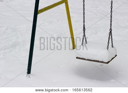 Close-up of chain swing in snowy area
