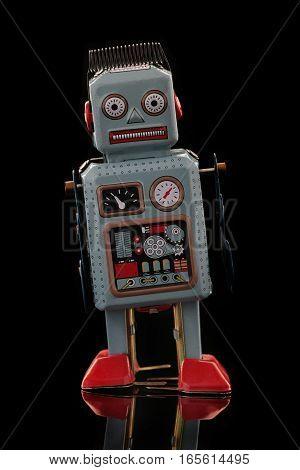 Retro Tin Robot on a black background