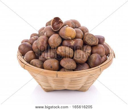 roasted chestnuts in basket on white background