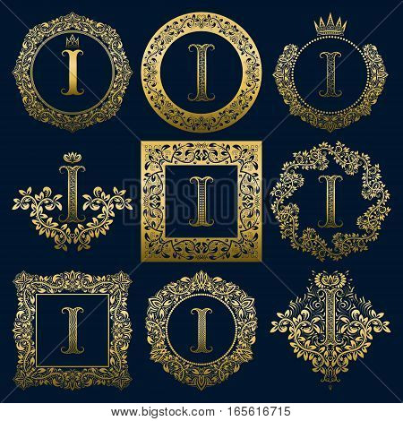 Vintage monograms set of I letter. Golden heraldic logos in wreaths round and square frames.