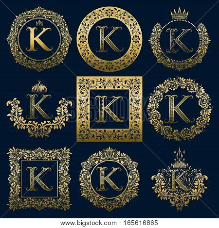 Vintage monograms set of K letter. Golden heraldic logos in wreaths round and square frames.