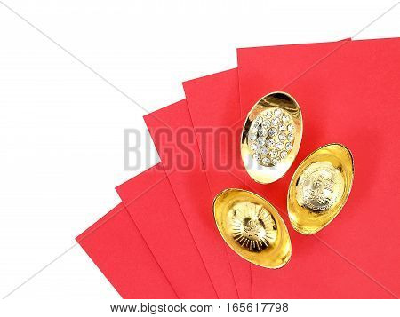 top view antique chinese gold ingot on red red envelope isolated on white background (chinese characters mean auspicious blessing of good fortune), Chinese New Year gift