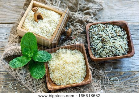 Different Varieties Of Rice In A Wooden Bowl.