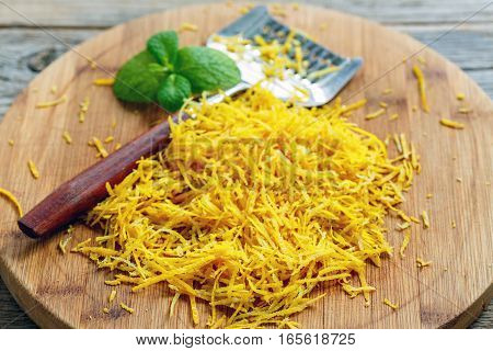 Wooden Cutting Board With Grated Lemon Peel.