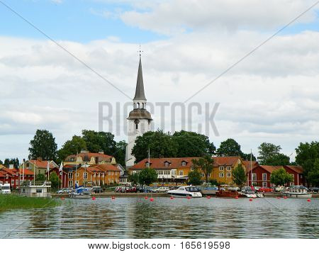 The picturesque Mariefred town with Karnbo church by the lake Malaren, Sweden