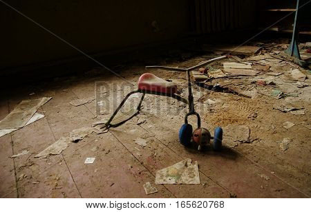 Soviet Toys Of Rusty Baby Bike In Chernobyl Nuclear Disaster Area.