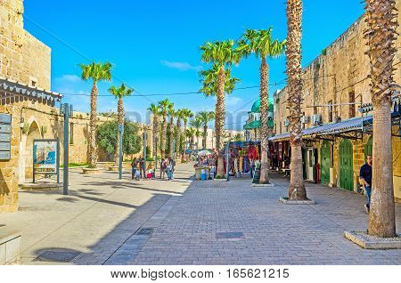 ACRE ISRAEL - FEBRUARY 20 2016: One of the central city streets with the small tourist market leads to the Al-Jazzar Mosque on February 20 in Acre.