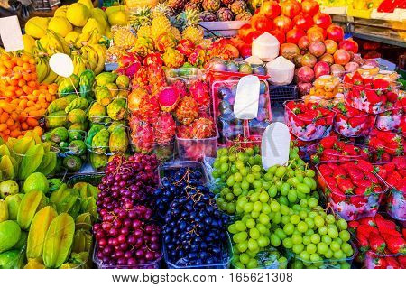The fresh flavored colorful juicy fruits in the stall of Carmel market Tel Aviv Israel.