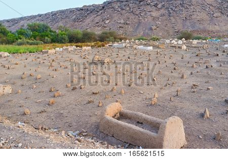 All the graves in muslim cemetery placed at right angles to Mecca Nagaa Al Khalasab Upper Egypt.