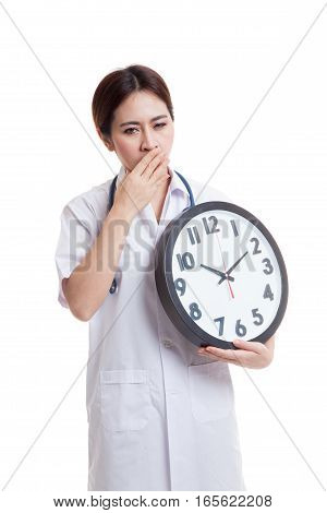 Young Asian Female Doctor Yawn With A Clock.