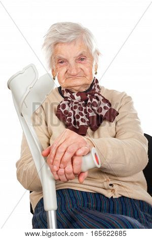 Picture of a happy elderly woman holding her crutch