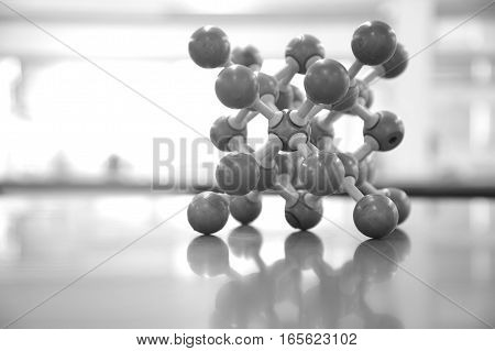 molecular chemical structure model on lab science table background