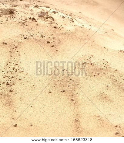 Surface from brown sand as background close up