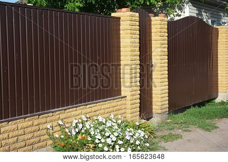 New Brick and Metal Fence with Door and Gate Installation