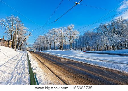 City road covered with fresh white snow after a heavy blizzard in Gdansk Poland.