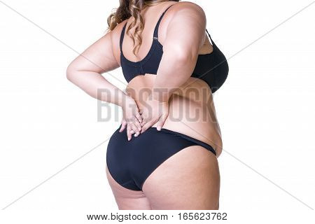 Plus size model in black lingerie overweight female body fat woman with cellulitis on thighs posing isolated on white background back view