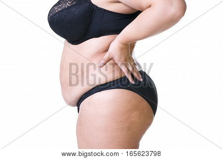 Plus size model in black lingerie overweight female body fat woman with flabby stomach posing isolated on white background