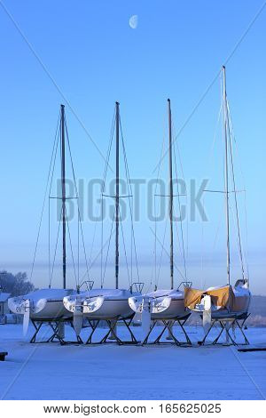 Yachts on winter storage in the early morning