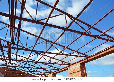 Steel Roof Trusses. Roofing Construction. Metal Roof Frame House Construction with Steel Roof Trusses Details.