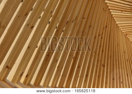 Closeup on at a timber structure in the sunlight