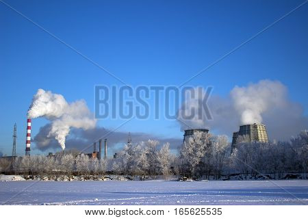 View from the City of the frozen pond on factory chimneys