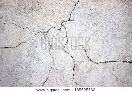 Cracked Concrete Wall Covered With Gray Cement Texture As Background For Design