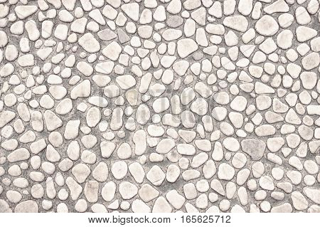 Wall Of Small Stones, White Background  Light Design