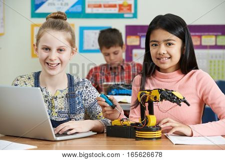Portrait Of Pupils In Science Lesson Studying Robotics