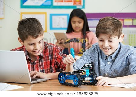 Pupils In Science Lesson Studying Robotics Together