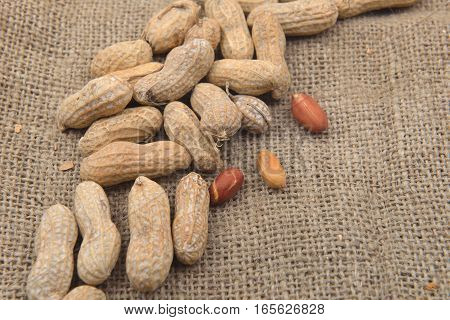 Close Up Peanut In The Shell And Without Shell On A Jute Background. Healthy Food