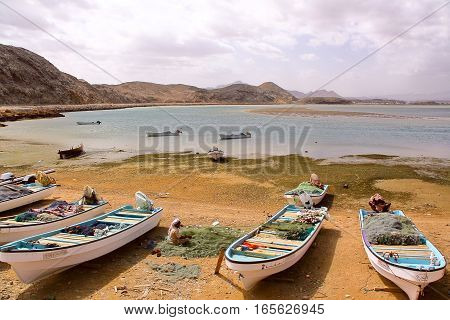 SUR, OMAN - FEBRUARY 6, 2012: A fisherman working on his fishing net on the beach in Ayjah