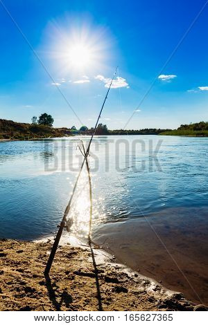 Fishing Rod On The Bank Of The River In The Afternoon